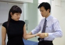 Dr Kevin Yip examining a patient